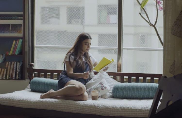 Radhika Apte reading a book