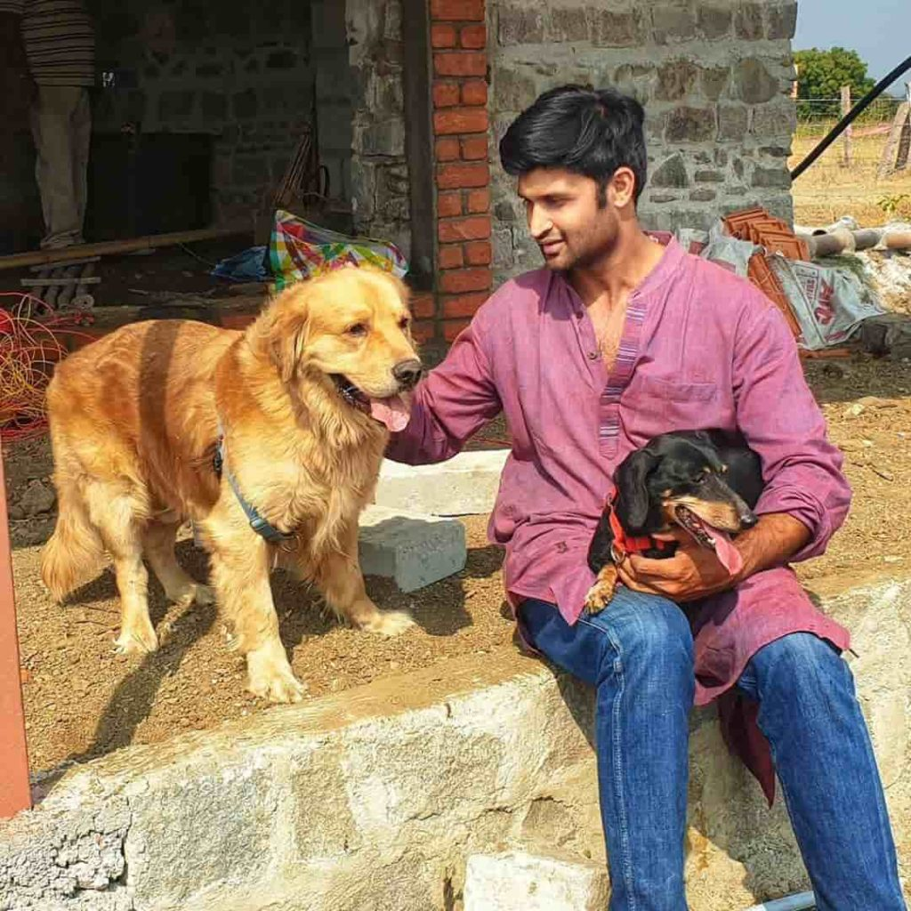 Kamal Kamaraju with Dogs